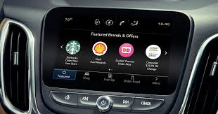 https://www.cnet.com/roadshow/news/gm-marketplace-lets-your-car-buy-donuts-and-coffee/